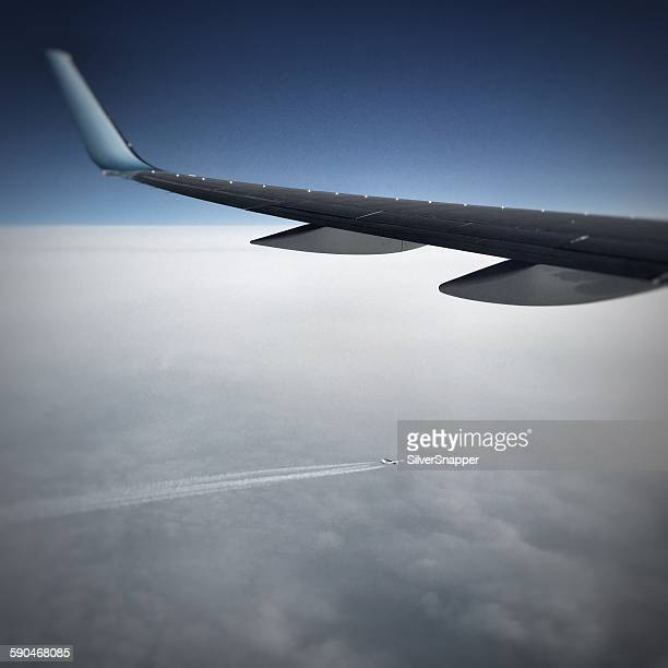 Airplane flying in sky above another plane