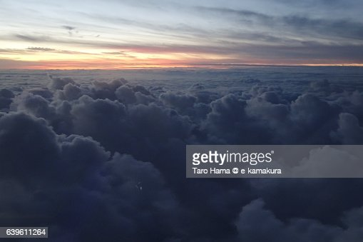 Airplane flying on sunset cloud