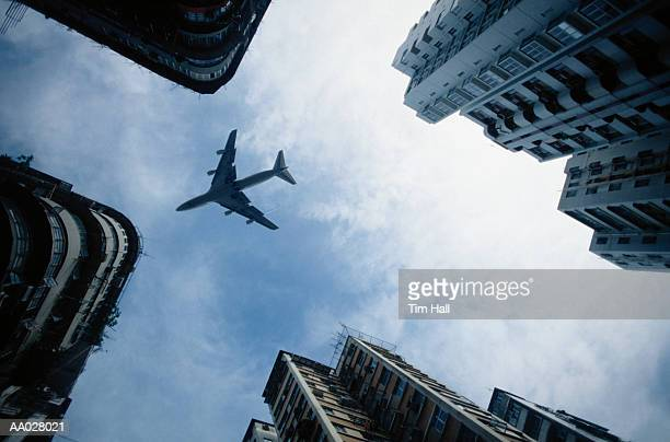 Airplane Flying Over Skyscrapers