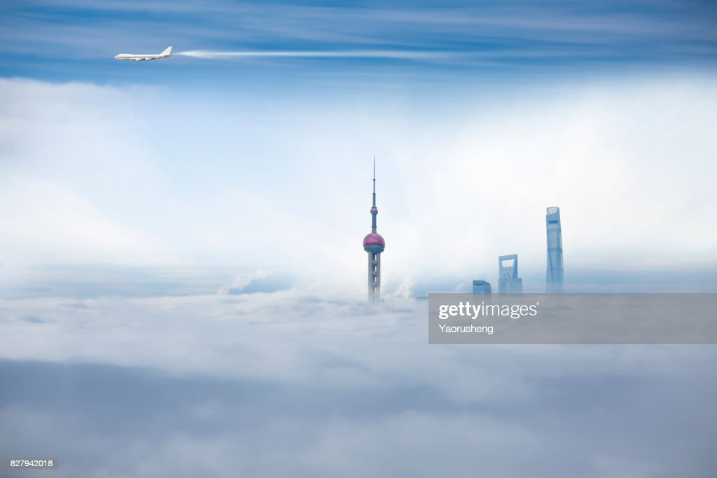 Airplane flying over the Shanghai City Scenery,Lujiazui commerical buildings in the fog : Stock Photo