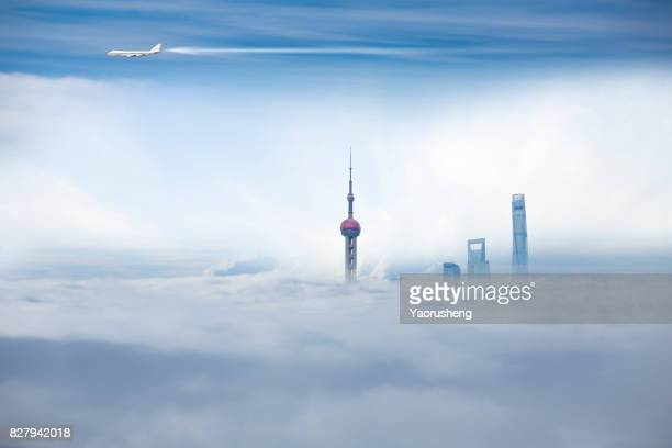 Airplane flying over the Shanghai City Scenery,Lujiazui commerical buildings in the fog