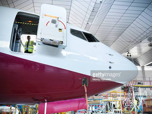 Airplane inspector onboard jet aircraft in hangar
