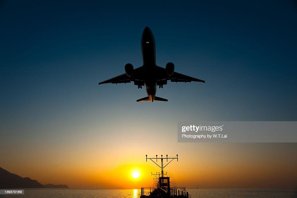 Airplane landing at HK International Airport