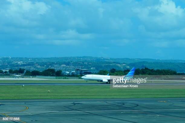 Airplane landing at Ngurah Rai Bali Airport, Indonesia