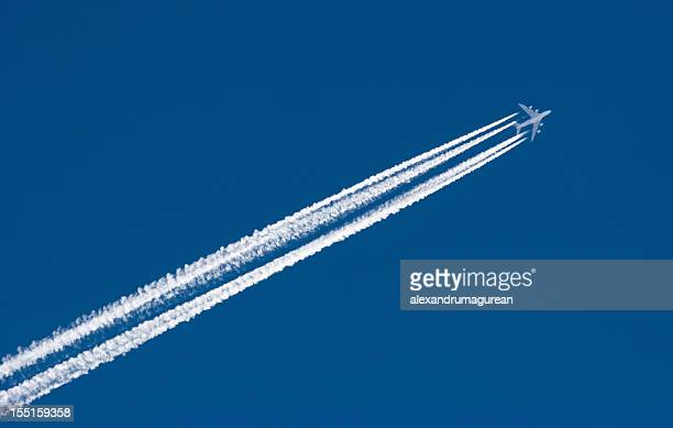 Airplane Leaving Contrail with four lines of smoke behind it