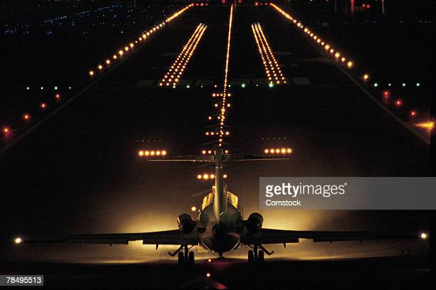 Airplane on runway at night