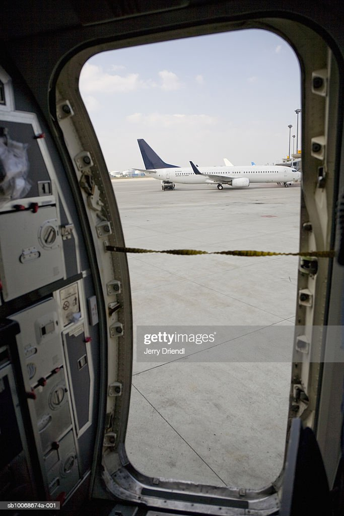 Airplane on tarmac seen from airplane door : Stock Photo & Airplane On Tarmac Seen From Airplane Door Stock Photo | Getty Images Pezcame.Com