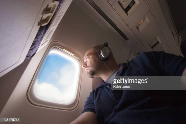Airplane Passenger Looking Out Window