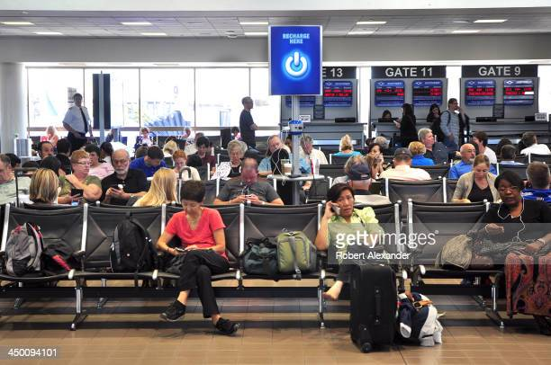 Airplane passengers wait at the gates for their flights at Los Angeles International Airport