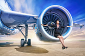 young woman sitting in a jet engine