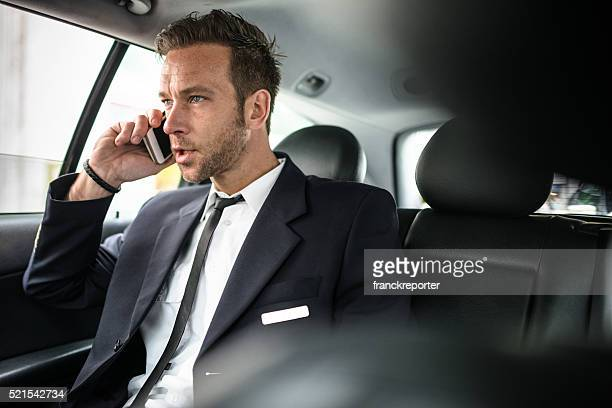 Airplane pilot on the phone in the taxi