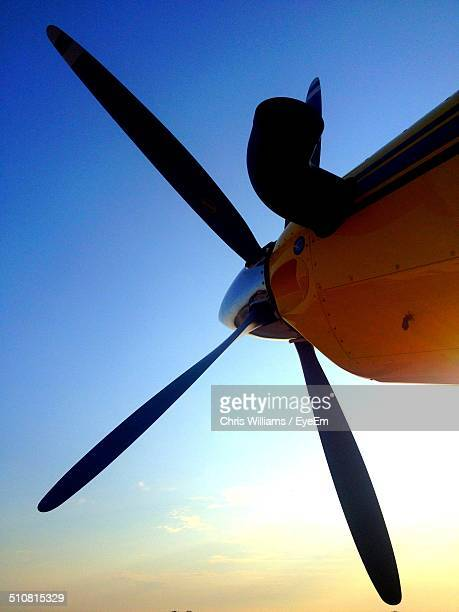 Airplane propeller in the sunset