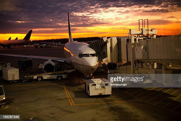 Airplane refueling at sunrise