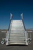 Airplane staircase on tarmac