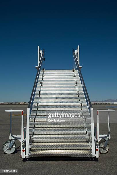Airplane staircase on tarmac