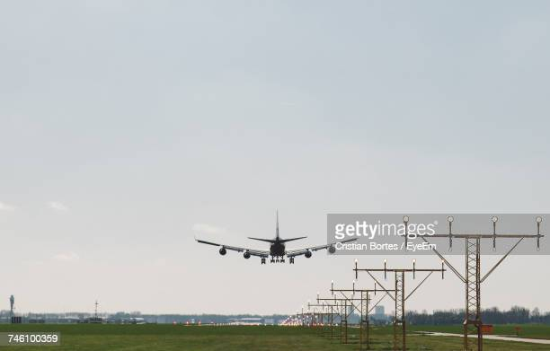 Airplane Taking Off From Airport Runway Against Clear Sky