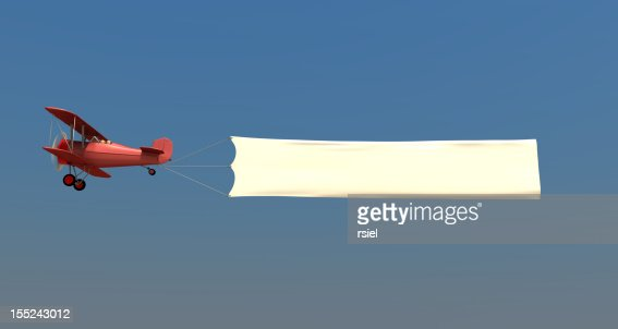 Airplane towing a banner