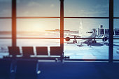 airplane waiting for departure in airport terminal, blurred horizontal background with place for text