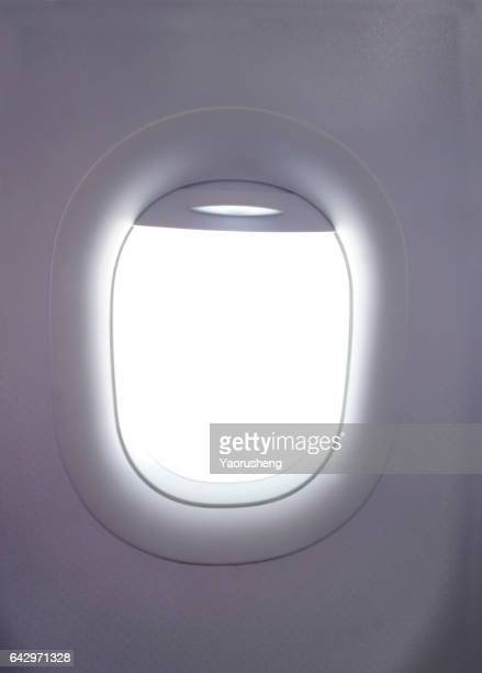 Airplane window,with bland copy space