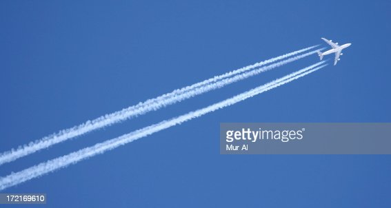 Airplane with contrails