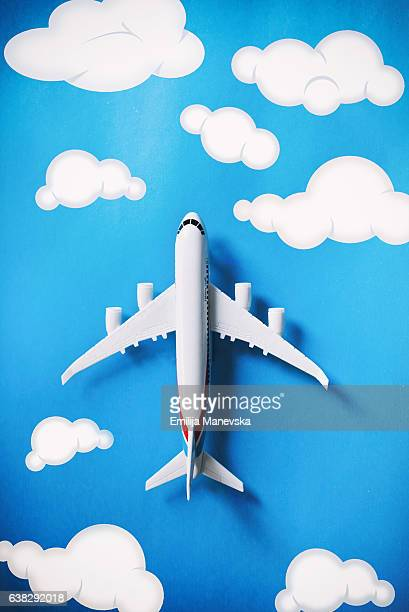 Airplane with hand drawn realistic clouds