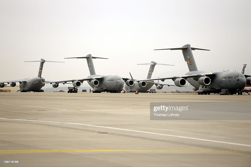 Airplanes await deployment as Soldiers of the U.S. Army Europe's 10th Army Air and Missile Defense Command, who operate Patriot anti-missile systems, load cargo on board a plane C-5 Galaxy for Turkey at Ramstein Air Base on January 8, 2012 near Ramstein-Miesenbach, Germany. The troops are deploying along with Patriot batteries from Netherlands and Germany as part of a NATO operation called 'Active Fence Turkey' meant to protect Turkey, which is also a NATO member state, from possible missile attack from Syria.