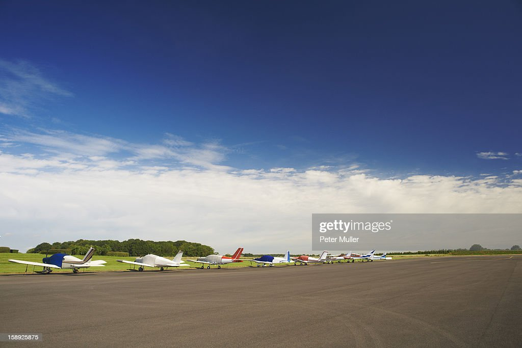 Airplanes parked on airstrip : Stock Photo