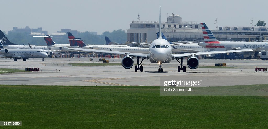 Airplanes queue up on the taxiway before departing Ronald Reagan National Airport May 27, 2016 in Arlington, VA. According to AAA, 'more than 38 million Americans will travel this Memorial Day weekend. That is the second-highest Memorial Day travel volume on record and the most since 2005. Spurred by the lowest gas prices in more than a decade, about 700,000 more people will travel compared to last year.'