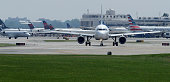 Airplanes queue up on the taxiway before departing Ronald Reagan National Airport May 27 2016 in Arlington VA According to AAA 'more than 38 million...