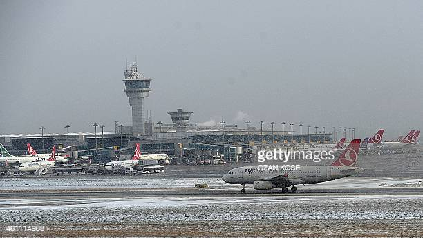Airplanes stand in snow on January 6 2015 at Ataturk airport in Istanbul 51 takeoffs and landings were cancelled due to heavy weather conditions AFP...