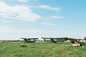 Airplanes standing on green grass. Two old biplane in a retro style. biege aircraft. Ukraine, 2016