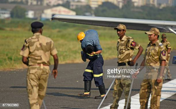 Airport authority of India Maharashtra police and state fire brigade conduct a safety mock drill at Juhu Airport on November 22 2017 in Mumbai India