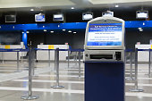 An auto check-in machine out of service at the check-in  counters area inside a Greek Airport.