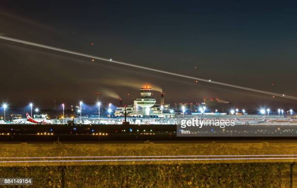 Airport Berlin-Tegel (TXL) with approaching aircraft at night- (Berlin-Reinickendorf, Germany)