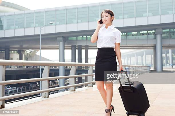 Airport business woman with cellphone