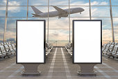 Airport terminal lounge. Two blank billboard stands and airplane on background. 3d illustration