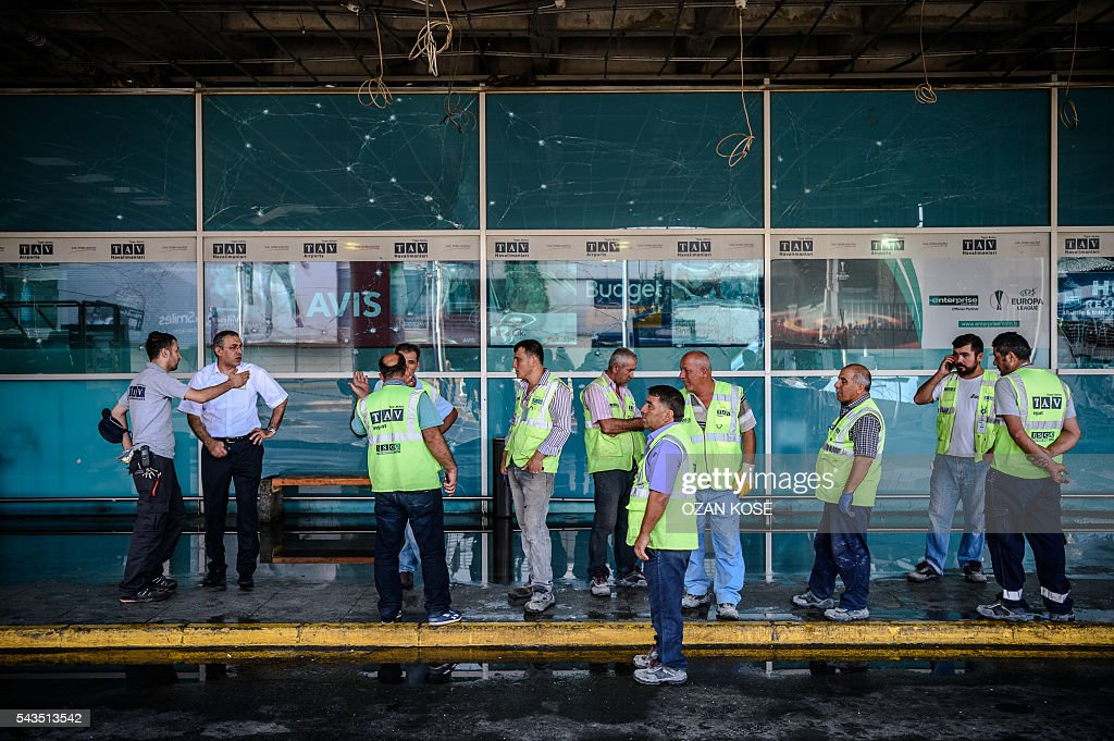 Airport employees gather at Ataturk airport's International airport on June 29, 2016, a day after a suicide bombing and gun attack targeted Istanbul's airport, killing at least 36 people. A triple suicide bombing and gun attack that occurred on June 28, 2016 at Istanbul's Ataturk airport has killed at least 36 people, including foreigners, with Turkey's prime minister saying early signs pointed to an assault by the Islamic State group. / AFP / OZAN