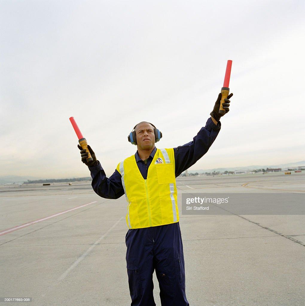 Airport ground crew directing aircraft