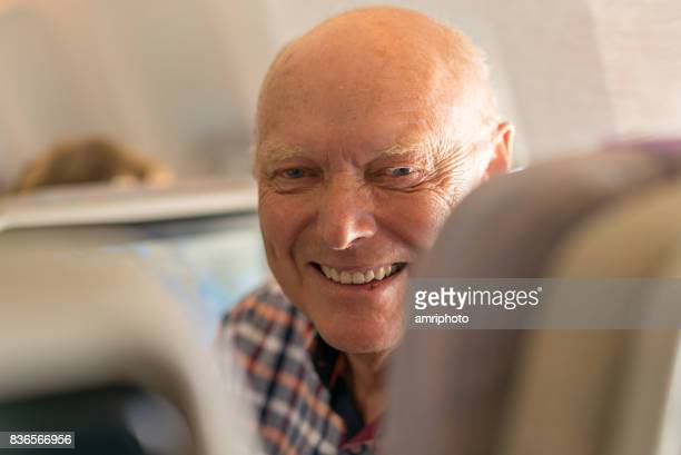 Airport, happy smiling senior passenger