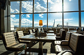 Airport seating area for business travellers with tablets and pay stations