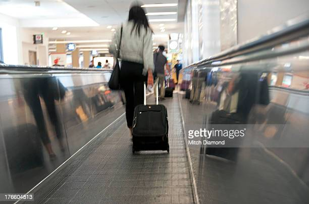 airport passengers on moving walkway