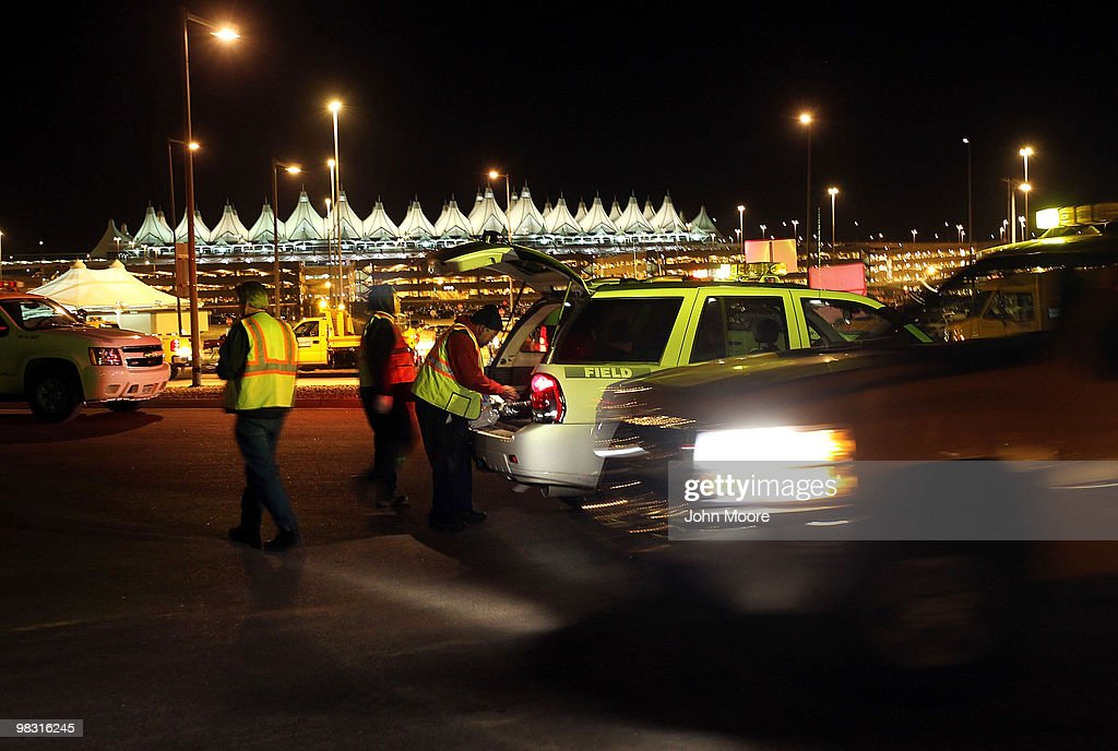 Airport personnel stand positioned outside the main terminal of the Denver International Airport on April 7 2010 in Denver Colorado In what was...