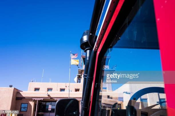 Airport, red car and blue sky.