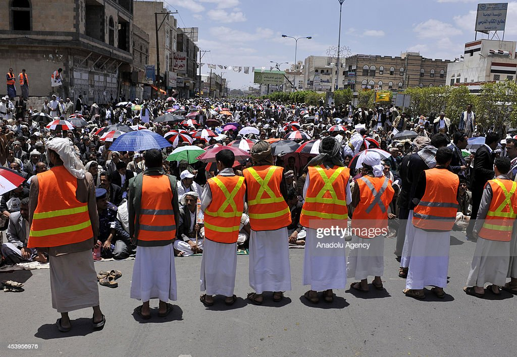 Airport road is pedestrianized due to anti-government protest of crowded demonstrator in Sanaa, Yemen on 22 August, 2014.