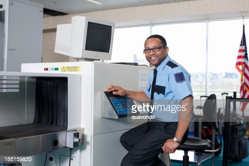 Airport Security Check Point with African American Guard