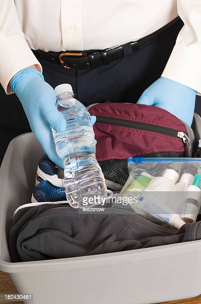 Airport Security TSA Agent Finds a Bottle of Water