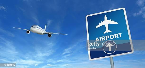 Flughafen Schild und fliegenden Flugzeug