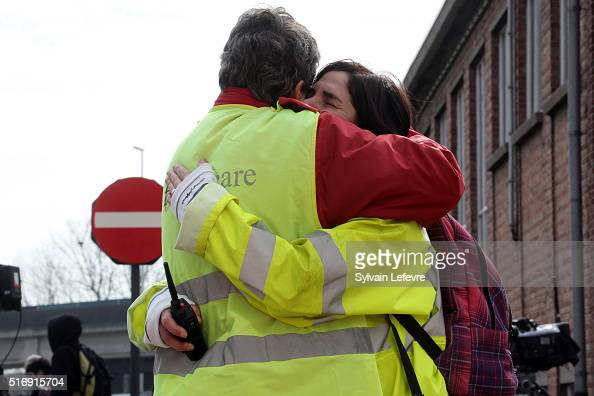 Airport staff comfort each other as passengers are evacuated from Zaventem Bruxelles International Airport after a terrorist attack on March 22 2016...