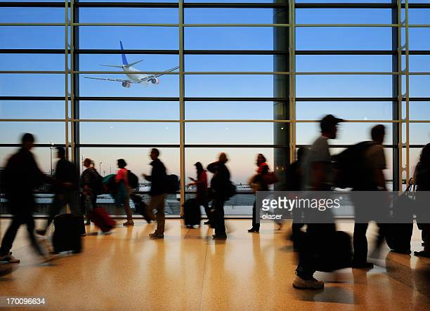 Airport terminal, glass windows and airplane