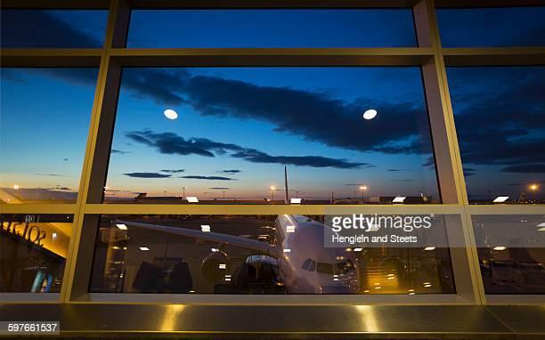 Airport terminal window view of airplane, New York, USA